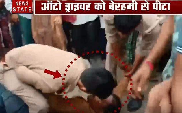 Uttar pradesh: देखिए मथुरा में कैसे एक ऑटो ड्राइवर को बीच सड़क पर पीट रहे हैं पुलिस वाले